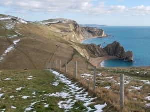 Snow dusting over Durdle Door looking east February 2019