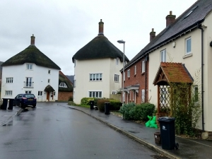 Thatched houses on new estate at Augustan Avenue, Shillingstone