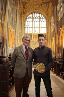 Peter Neal presenting Geography award to Joseph Bishop, at the Gryphon School Prize Ceremony, held in Sherborne Abbey on 16th September 2017.