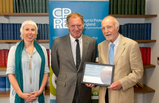 Sam Harding with Sir Andrew Motion presenting award to volunteer and CPRE Member Bob Kerr, Dorchester Stop the Drop