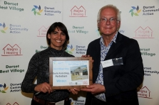 Jo Worsley receiving Dorset Best Village Shop award from Rupert Hardy