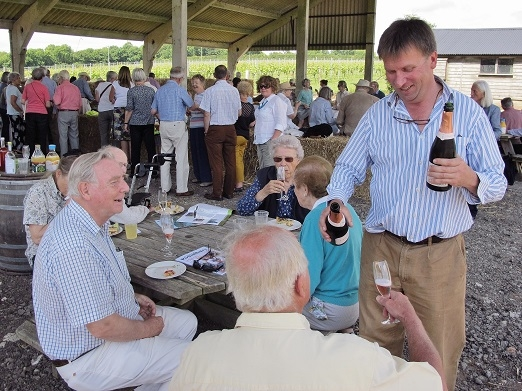 Justin Langham pours wine for CPRE members